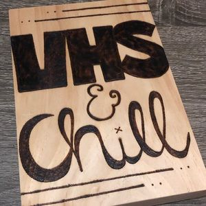 VHS & Chill wood burned wall sign